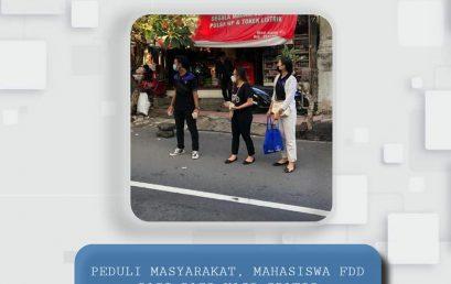 PEDULI MASYARAKAT, MAHASISWA FDD BAGI-BAGI NASI GRATIS